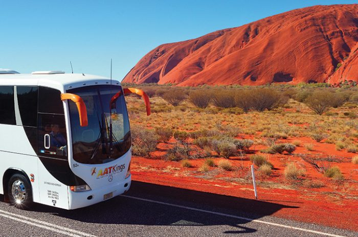 Escorted tour passing Ayers Rock