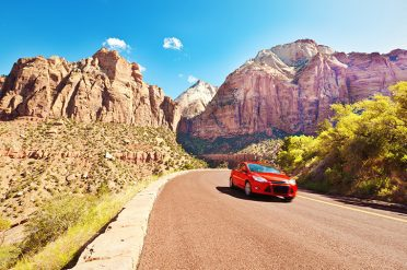 Car driving through Arches National Park