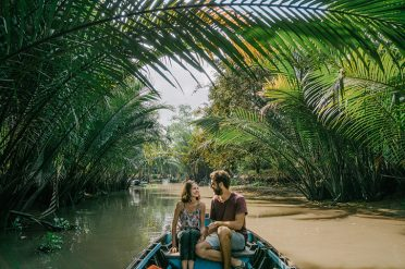Couple in boat on the Mekong Delta