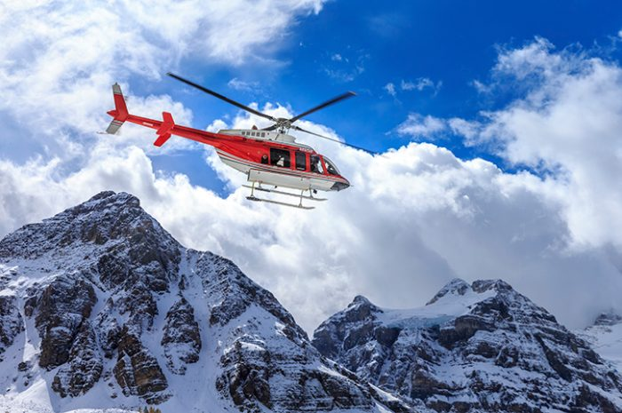 Helicopter Flying Over The Rockies