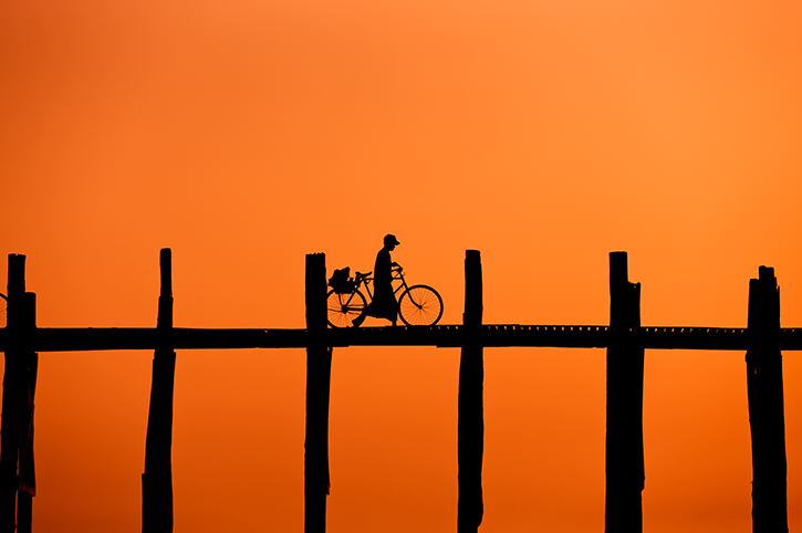 Burmese Man Crossing U Bein Bridge