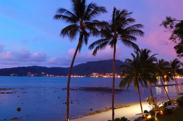 Palm-trees-and-sunset-over-Patong, Thailand