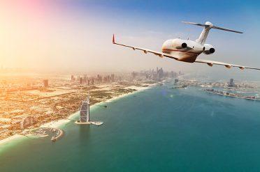 Plane Flying Over Dubai
