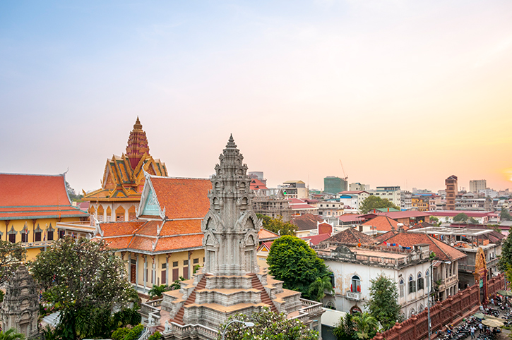 Skyline view of Wat Ounalim at sunset in Phnom Penh