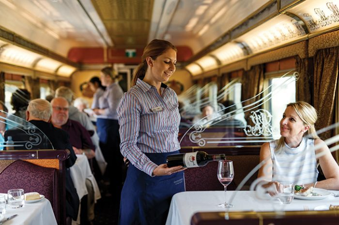 The Ghan Staff Serving Guest